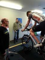 Coach Mike & bike fit expert, Hal, working through a bike fit with a BarryS Coaching Client